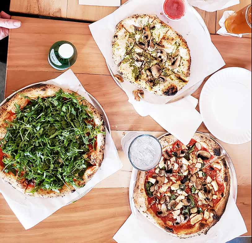 Pizza Party! A garlic flat bread, Tomasso and Pizza with Arugula